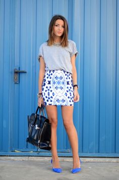 print skirt with tee and bright blue shoes