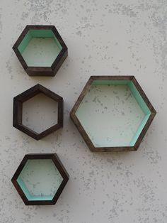 This hexagon shaped shelf can add a splash of color to brighten up your decor while giving you a space to display your favorite items,