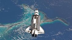 How was this picture taken from above the space shuttle? Aliens invading!