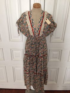 A personal favorite from my Etsy shop https://www.etsy.com/listing/277148376/vintage-1970s-floral-peasant-sundress
