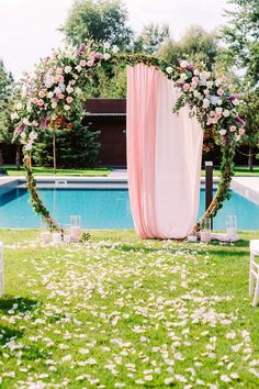 Outdoor wedding ceremony arch with flowers and draping from CV Linens. Click to shop our affordable wedding and party supplies! This wedding ceremony arch is the perfect wedding canopy arch for a romantic intimate small backyard wedding. Spring and summer wedding backyard DIY wedding decorations. Backyard summer wedding in the garden with a small wedding reception and ceremony party. wedding ceremony ideas, wedding arch