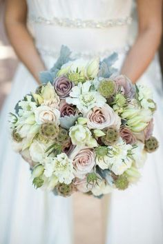 Large Hand Tied Bridal Bouquet Showcases: Cream/Champagne/ Beige Roses, Amnesia Roses, Blushing Bride Protea, White Scabiosa, Scabiosa Pods, Eryngium Thistle, & Dusty Miller****