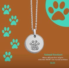 lia sophia ANIMAL INSTINCT paw print in crystals w very cute bone hanging at clasp. Perfect for the animal lover in your life!