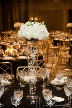 Strands of White Pearl Balls Decorated Inside of Tall Glass Vase Centerpiece and White Hydrangea and Lisianthus Up Top - The French Bouquet - Chris Humphrey Photographer