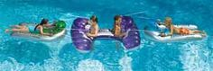 Inflatable docking port for 2 kids plus 2 inflatable floats all with constant supply water pistols.