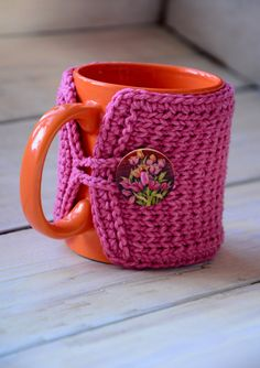 Pink cup cozy. Wooden tulip button. Knit Mug warmer with flower button. House warming gift.