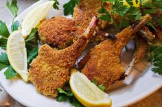 Parmesan Lamb Chops Recipe Main Dishes with rack of lamb, rib, pepper, salt, bread crumbs, grated parmesan cheese, fennel seeds, rosemary, flour, black pepper, salt, cayenne, small eggs, olive oil, parsley sprigs, lemon wedge