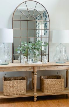 Welcome your guest in style with a pretty entry Everett foyer table styling with pretty lamps arch mirror and baskets thehomeicreate entrywaydecor entrywaydecorideas entryway foyerdecorating foyerdesign lampmakeover Foyer Design, House Design, Entry Tables, Sofa Tables, Farm House Entry Table, Hallway Tables, Farmhouse Entryway Table, Table Lamps, Foyer Decorating