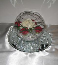 Water beads, acrylic ice, mirror, fishbowl vase, but with fresh roses - no water = less mess to clean up at the end.