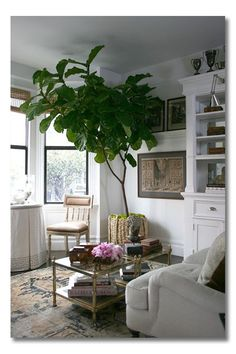 A quick list of Simple ideas from this idea packed corner will jump start your living room and display decor. Such a fresh and pretty space! #interiors #interiordesign