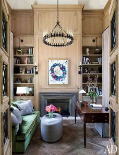 architectural digest, gisele bundchen office, emerald sofa, gray ottoman, built-in shelves
