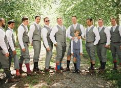 Men, Don't be afraid to express yourselves! Have fun doing it, and always show it off!!!! What a fun idea to wear some crazy socks! Those Cole Haan wingtip oxfords aren't looking to shabby either. Matching shoes make for a great gift of appreciation, from the groom to his groomsmen! Well done gentlemen! Photo Credit- Loren Ruthier Photography