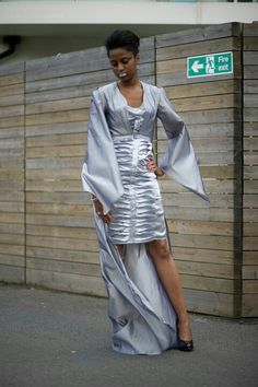 First university collection 'Past + Present = Future sq' Silver pleated dress with removable train jacket Photographer: Karen Storey Model: Araba Makeup: Monica Hair: Amelia