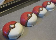 One dozen Pokemon pokeball chocolate covered sandwich cookie oreo party favors.