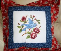 Pillow embroidered with bird and blooming branches circle machine embroidery design.