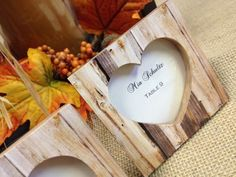 "Rustic Wedding Favors l ""Rustic Romance"" Faux-Wood Heart Place Card Holder/Photo Frame http://timelesstreasure.theaspenshops.com/rustic-romance-wood-place-card-holder.html"