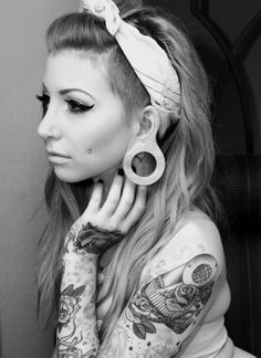 The extremely stretched lobes are a little much, but she's stunning.
