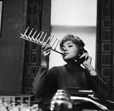 Cigarette Pack Holder, 1955 - LIFE: Dumb Inventions.  Smoke a whole pack at a time.......what a great brain fart.