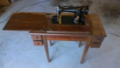 Ann decorating Room Caris.  1952 sewing machine from Aroney school.  Made Caris a a cute little desk for her room.