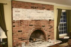 White Washed Brick Fireplace Tutorial - Use: latex paint (Sherwin Williams Cashmere - Medium Lustre - Luminous White) water, paint brush, rag