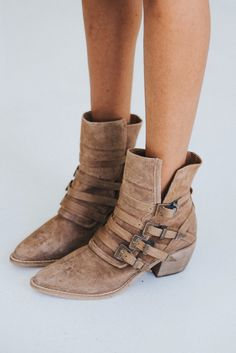 DETAILS: Western-inspired suede boots featuring multiple adjustable buckle accents with metal detailing. Pointed toe and stacked heel complete the look....