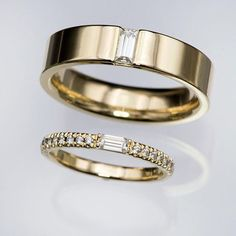 Custom made wedding bands for a lovely couple. ❤️ While the rings are both different to suite each persons style, they do share common elements like the baguette moissanite and the same yellow gold material. Custom Wedding Rings, Gold Wedding Rings, Gold Rings, Wedding Bands, Wedding Ring For Men, Couple Rings Gold, Wedding Ideas, Engagement Rings Couple, Engagement Ring Settings