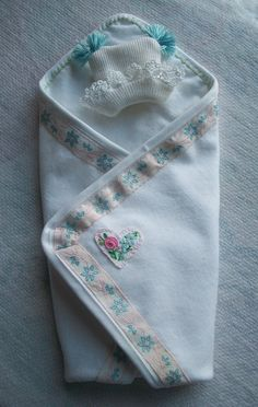 Jenny's Dresser Drawer blog...13-15 week size cashmere blanket with  hand embroidered heart lined  with flannel and angora hat.  These sets include a pillow for support and an inner swaddle cloth of flannel for absorbency.