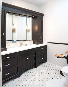 Mullet Cabinet - A built-in Vanity featuring overhead recessed lighting.