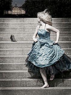 Cinderella running, darkness, looking back.