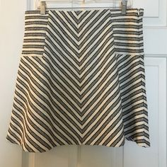 Ann Taylor LOFT skirt. Large Petite. Adorable LOFT skirt. Black and off white. Lined. Side zipper. Very cute and comfy! Worn twice. LOFT Skirts Circle & Skater