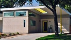 Love the punch of color on this grey home. SOL Austin :: Modern Austin Homes :: modern homes austin 1140