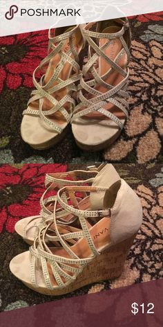 Rhinestone Wedged Heels. Beige/Light Tan wedged heels, with a strapping look over the foots that is details with rhinestones. Very pretty. Very flashy. Worn only twice, (very skinny feet & these heels do not work well) Vanity Shoes Wedges