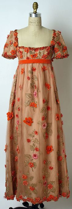 Orange sequined, beaded and embroidered silk and rayon evening dress by George Halley, American (New York), c. 1967.