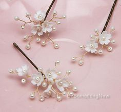 Set of Three Wedding Hair Pins of Flowers and Pearls Bridal Hair Pin Set, Dainty Polymer clay flowers in a pearly white/off white shade are wired with tiny pearls on gold wired creating these pretty hair pins. These will be beautiful tucked into your hair on your wedding day or for a