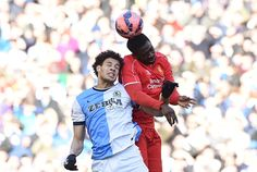 Blackburn's French-born Beninese striker Rudy Gestede (L) vies with Liverpool's Ivorian defender Kolo Toure (R) during FA Cup quarter-final match between Liverpool and Blackburn Rovers at Anfield in Liverpool, north west England on March 8, 2015.