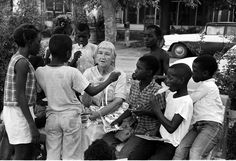 Summer of 1964 - An elderly female volunteer for the Freedom Summer Movement works with children. The Freedom Summer, also known as the Mississippi Summer Project, was a movement to register as many new African American voters as possible in Mississippi during the summer of 1964.