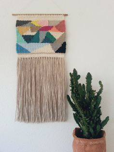 Handwoven wall tapestry.  Handmade in a homemade loom, with love and patience.  Made with 100% natural fibers (a mix of cotton, wool and