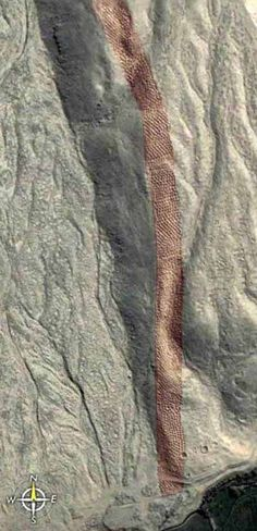 A stretch of thousands of mysterious holes carved into the rock, that lead up a hill, located on the same plateau, not far from the Nazca lines.