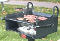 The original Infinitely Adjustable cooking grate design on the Premier Park Grill lets you adjust the cooking surface anywhere from just above the coals to 12 inches above bottom of firebox.  • Cooking Grate tips back out of grill firebox yet remains attached, for easier fire building and clean out.