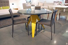 is introducing this modern table with bright yellow legs this spring. Get this table in a variety of options. Modern Table, Bright Yellow, Showroom, Dining Table, Legs, Spring, Furniture, Home Decor, Homemade Home Decor