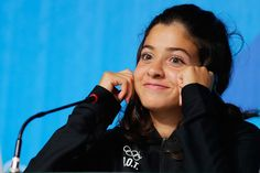 Olympic Syrian refugee who swam for three hours in sea to push sinking boat carrying 20 to safety.