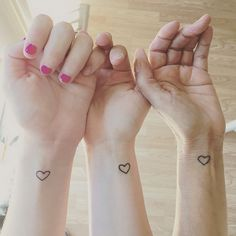28 Sister Tattoos - Three hearts beating as one.