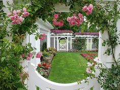 LOVE it all, the gate, the white fencing, the gorgeous climbing roses, the verdant lawn........pure perfection!!!!