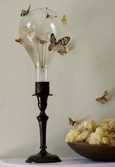 Vellum moths on display via urban comfort. Insert light bulb into vintage candlesticks with poster putty. Print out moths on vellum paper. Light Bulb Art, Light Bulb Crafts, Recycled Light Bulbs, Butterfly Centerpieces, Luminaria Diy, Fluorescent Lamp, Old Lights, Energy Efficient Lighting, Idee Diy