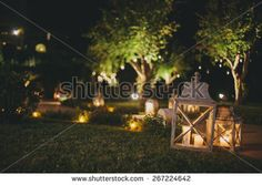 Lamps and candles at night - stock photo