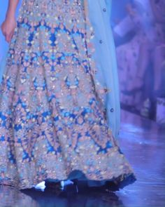 Seaside Blue Lehenga As soon as this seaside blue lehenga turned around on the runway, show-goers gasped and immediately whipped out their smartphones for a picture. The concept of this bridal masterp Pink Bridal Lehenga, Gold Lehenga, Designer Bridal Lehenga, Lehenga Choli, Anarkali, Indian Bridal Outfits, Bridal Dresses, Fashion Bazaar, Bridal Lehenga Collection