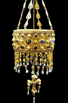 Visigoth votive crown (7th century CE) -  Treasure of Guarrazar, near Toledo (Spain). Created as a votive offering, the crown is modeled according to Byzantine forms, but the technique of gem encrustation (blue sapphires from Sri Lanka, pearls, onyx and other precious stones) is typically Gothic