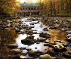 Bridge over Rocky Waters by Danny Head Wrapped Photographic Print on Canvas