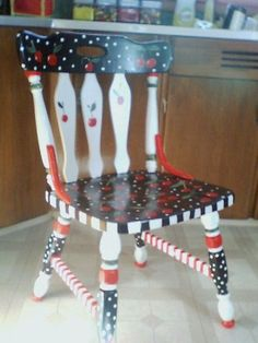A pinner said: My cheery cherry chair, Mary Engelbreit-style. I used black furniture enamel paint to cover a plain wood chair, then used acrylic paints to decorate, and finished with clear acrylic varnish to seal.