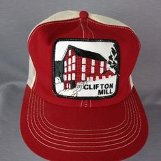 the best attitude b9acd 02a75 Clifton Mill Building with waterfall. K Products embossed on snapback. Red  and white with